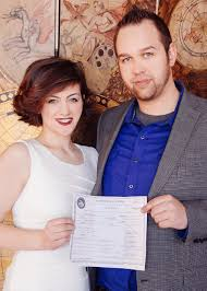 How To Get Married in Chicago     Small Weddings Chicago Newlyweds take a portrait with their Cook County marriage license