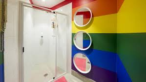 gay abandon a shower room with plenty of rainbow flair picture james horan airbnb sydney office