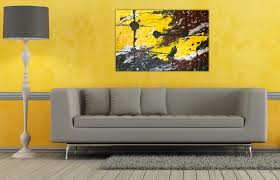 yellow living room paint with grey couch and wall art decorating also height stand lamp plan blue couches living rooms minimalist