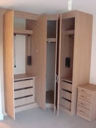 great space creating furniture with a corner wardrobe with pull down hanging rails designed bedroom corner furniture