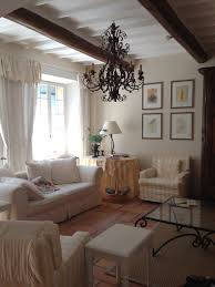 Dining Room Chandeliers Traditional This Glamorous Dining Room Balances Light Walls With Dark Wood And