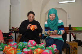 non profit creates jobs for palestinian refugee women artisans by cayl shireen and rahaf making puzzle balls at the artisan center in zababdeh west bank