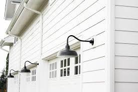better homes and gardens lighting black gooseneck barnlights on a white modern farmhouse on home lighting pic better homes and gardens lighting