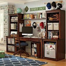twins style study room with wooden desk and rack and blue carpet for boys biege study twin kids study room