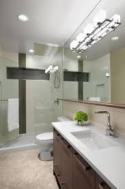 pleasing white lighting illuminate modern bathroom with rectangular wall mirror above stainless steel faucet bathroom lighting contemporary
