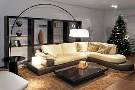 living room with low black platform coffee table plush beige sofa with brown base and beige furniture