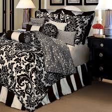 floral pattern bedding set and striped pattedn valance on queen size bed in black and white bedroom white bed set
