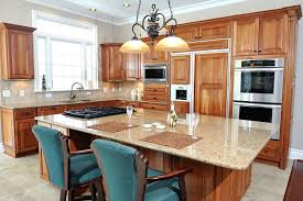 kitchen features natural wood toned cabinets