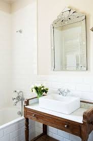 washstand bathroom pine: fantastic bathroom features a gray washstand painted farrow amp ball elephants breath accented with nickel cup pulls topped with a rectangular vessel sink