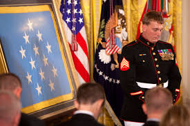 u s department of defense photo essay marine corps sgt dakota meyer bows his head in prayer before a the medal of