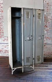 pair of vintage industrial steel metal lockers with brass knobs and number plate 10 brass and metal furniture