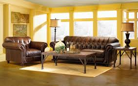 astounding sunroom living room design with dark brown leather sofa and rectangle coffee table along yellow astounding red leather couch furniture