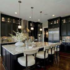 black and stainless kitchen great cabinets and lighting above island very rich