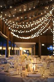 gorgeous rustic wedding details with tons of twinkle lights barn wedding lights