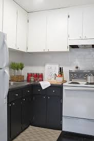 full size white top cabinets black lower cabinets white upper cabinets subway tile