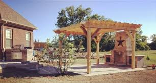 outdoor fireplace paver patio: outdoor living space with outdoor fireplace pergola paver patio and built in grill island