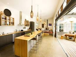 beautiful kitchen pendant lights above large cutting board over solid wood island countertops across sliding patio beautiful kitchen lighting