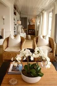 rattan chairs sunroom idea living rooms livingroom beach houses coastal living family room wicker chairs altra furniture owen student writing desk multiple