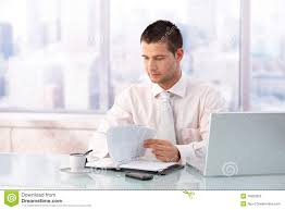 young businessman working in bright office royalty free stock photo bright office
