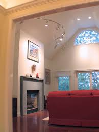 fireplace accent track lighting suspended from the ceiling ceiling ambient lighting