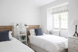 beach house cornwall inspiration for a beach style guest bedroom remodel in london with white walls bedroom furniture beach house