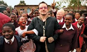 U2's Bono photographed with a group of Africa school children