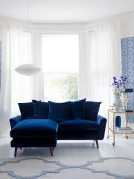 living inspiration example of a small trendy living room design in london with blue walls blue dark trendy living room