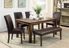 small dining tables sets: heres a rustic rectangle dining table with fully cushioned chairs and bench this look works