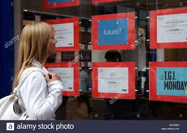 w looking for a job or career change vacancies being stock photo w looking for a job or career change vacancies being advertised in the window of recruitment agency premises job searching