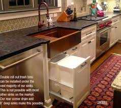 hammered copper kitchen sink: copper sink double roll out trash under a copper farmhouse sink