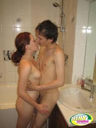 Teen Amateur Redhead Sister in Bathroom Giving Blowjob Image.