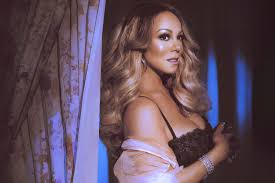 <b>Mariah Carey</b> Stays Current Without Losing Her Charm on '<b>Caution</b>'