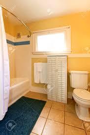 bathroom window yellow walls
