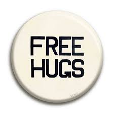 <b>Free Hugs</b> Badge – REMO General Store