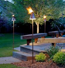 outdoor torch lighting. elevate the entryway with trendy cresset this cold winter by mckay landscape lighting outdoor torch t