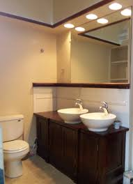 mid century modern bathroom vanity remodeling ideas with double white wash bowl above dark brown mahogany bathroom vanity lighting remodel custom