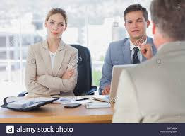 happy business people interviewing business man stock photo happy business people interviewing business man