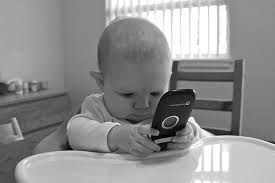 Image result for small baby with cell phone