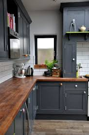 kitchen colors images: charcoal colored cabinets walnut countertops and black grouted subway tiles give this cozy