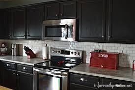 subway kitchen white subway tile backsplash with black cabinets hometalk