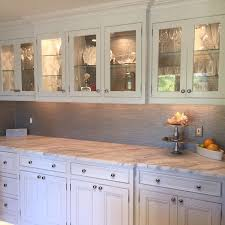 classic craft staggered kitchen cabinets make glass front cabinets your kitchens main attraction achieve this e