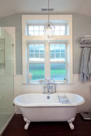 a mini chandelier makes a big style impact in the bath photo credit traditional bathroom lighting chandelier
