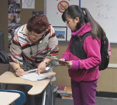 college classes for middle school students it s happening in seventh grader michelle cruz talks chabot college instructor nidia sanchez rico before class