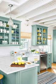 painted blue kitchen cabinets house: stratton blue kitchen cabinets with marble countertops