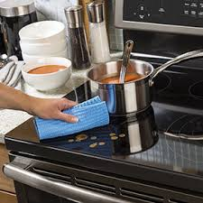 black appliance matte seamless kitchen: a seamless surface on electric ranges makes it easy to wipe away messes for gas