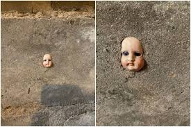 <b>Woman</b> Finds <b>Creepy</b> Doll's <b>Face</b> Cemented in Wall of Her New ...