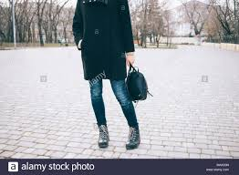 Stylish young slender woman stopped during a walk in early <b>spring</b> ...