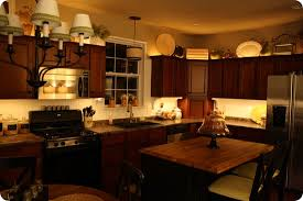 under cabinet lighting above cabinet lighting