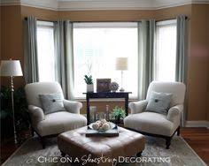 seating for the in front of the big window will need a larger console table bay window furniture