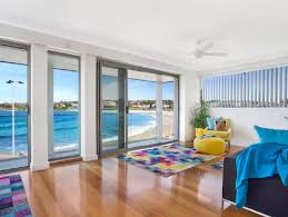 the living room boasts stunning views of australias most famous beach picture airbnb airbnb sydney